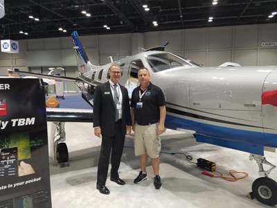 Image of a man standing next to an ICON Aircraft plane