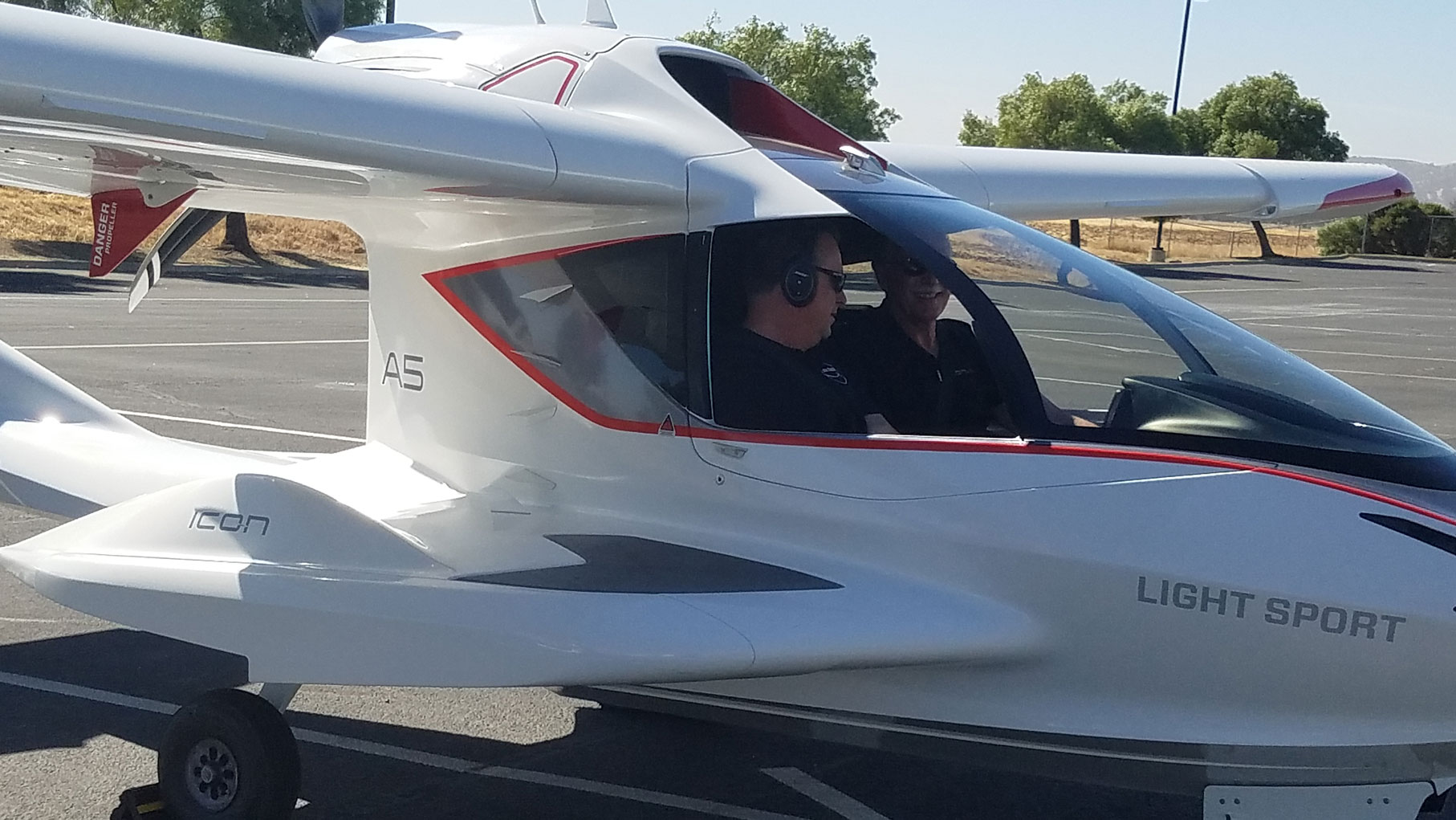 2 men inside ICON Aircraft plane