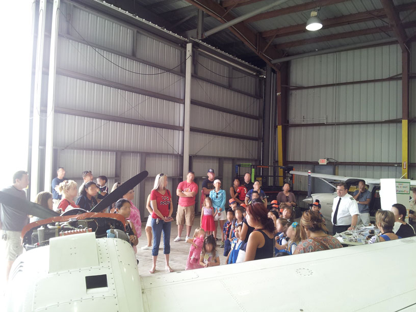 View of group in airplane hangar